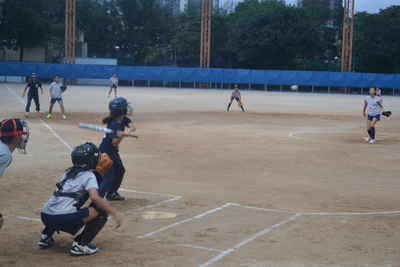 Natania ( 5 Love ) in attempt to bat the ball.