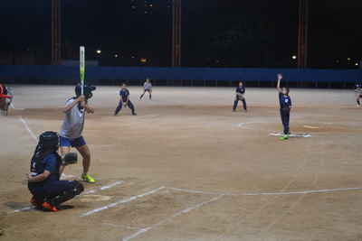 Lana ( 4 Peace ) was pitching the ball to the batter.